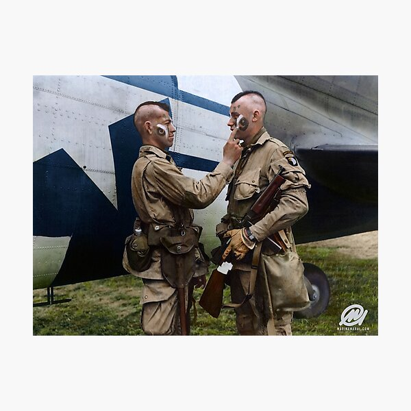 Filthy Thirteen member Clarence Ware applies war paint to Charles Plaudo. England, 31 December 1943. Photographic Print