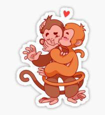 Two cute monkeys kissing.  Sticker