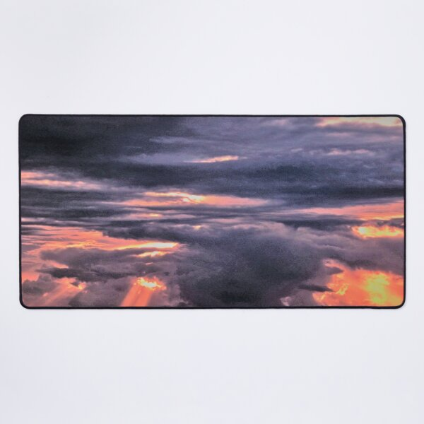 Mother nature loses her temper as Sun trys to shine. Desk Mat