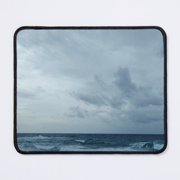 Choppy waves race for the shore under a cloudy winter sky Mouse Pad