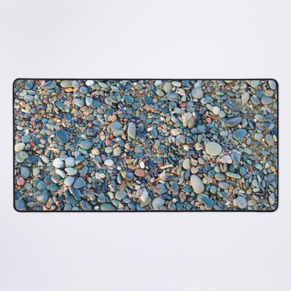 Stones and pebbles on the beach Desk Mat