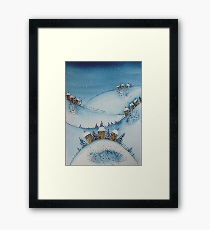 Houses on the Hills in the Snow Framed Print
