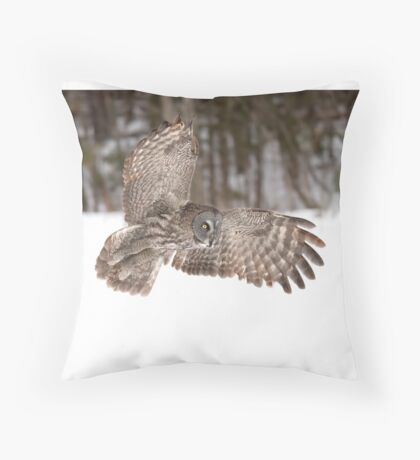 Great grey owl in flight over a snow covered field Throw Pillow