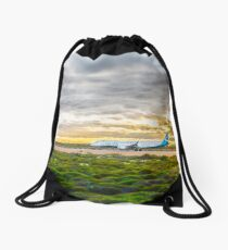 Last flight home Drawstring Bag