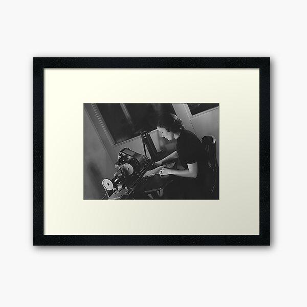 Woman at work Framed Art Print