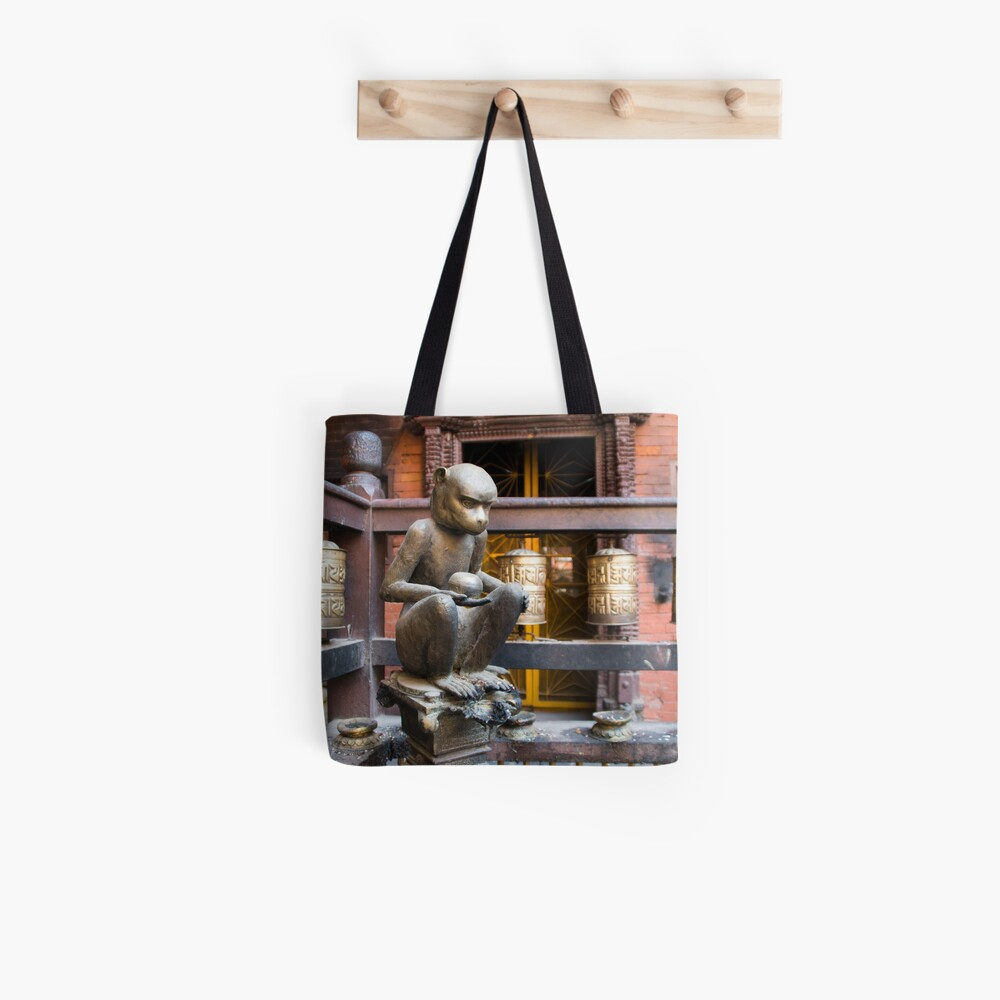 Monkey in a Buddhist temple Tote Bag