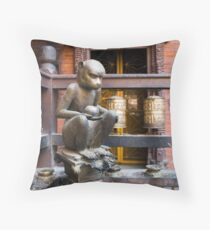 Monkey in a Buddhist temple Throw Pillow