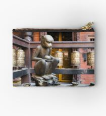 Monkey in a Buddhist temple Zipper Pouch