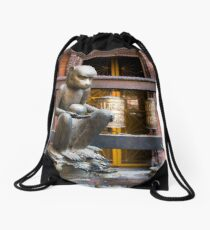 Monkey in a Buddhist temple Drawstring Bag