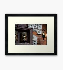 Bell and buddha eyes in a buddhist temple Framed Print