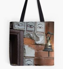 Bell and buddha eyes in a buddhist temple Tote Bag