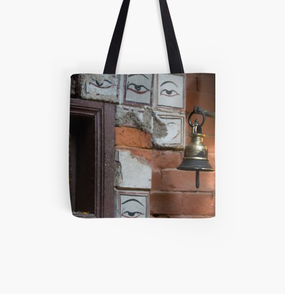 Bell and buddha eyes in a buddhist temple All Over Print Tote Bag