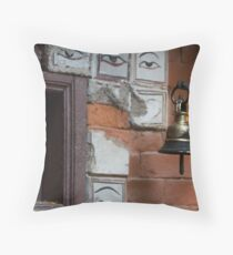 Bell and buddha eyes in a buddhist temple Throw Pillow