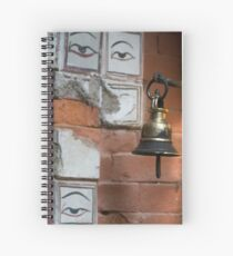 Bell and buddha eyes in a buddhist temple Spiral Notebook