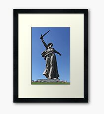 Giant sculpture of woman with sword Framed Print