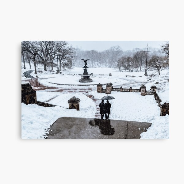 Winter in Central Park in New York City with Bethesda Fountain covered by snow Canvas Print