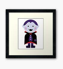 Child in vampire costume. Vector cartoon Framed Print