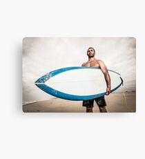 Surfer wathing the waves Canvas Print