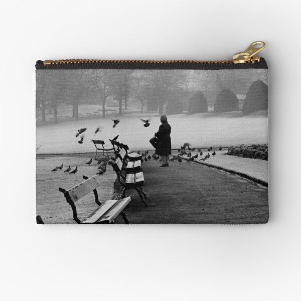 Shy woman feeding pigeons Zipper Pouch