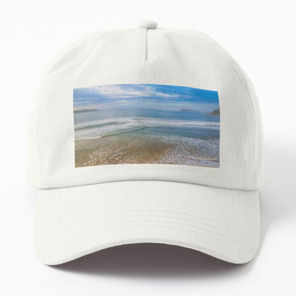 Early morning aerial views at the seaside with fog, cloud and waves Dad Hat