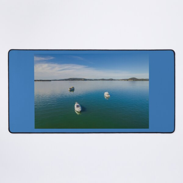 Daytime aerial waterscape with boats Desk Mat