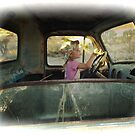 Lilly Driving Old Desert Truck by Peter B