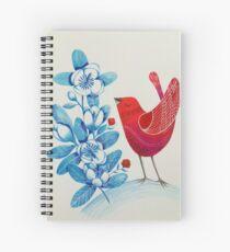 Red bird amongst blue flowers Spiral Notebook