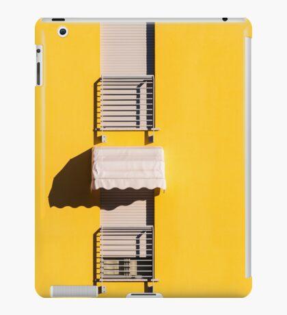Window with sunshade on a yellow wall iPad Case/Skin