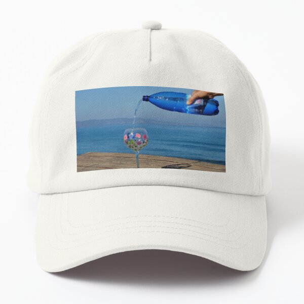 A steady hand pours sparkling water into a glass. Have a drink. Dad Hat