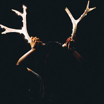 Girl Holding Deer Antlers with String Lights by DeniseLives