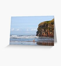 blur motion of dog running in sea by cliffs Greeting Card