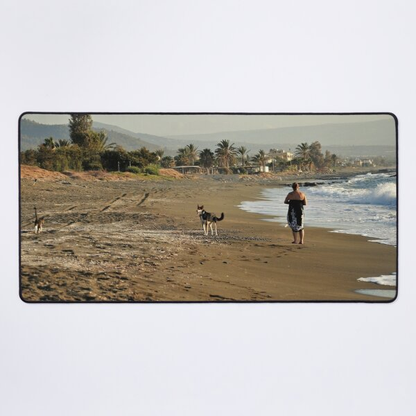 A dog takes his cat for a walk on the beach. Meeowww!      Desk Mat