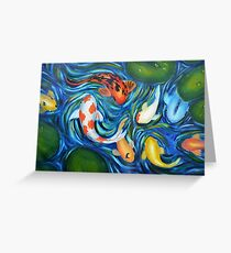 Koi circling in pond Greeting Card