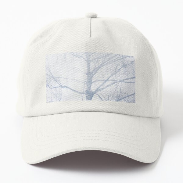 Wintry tree in the snow Dad Hat