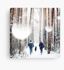 Young Family Having Fun with a Dog in Winter Canvas Print