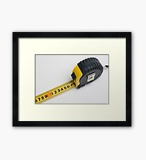 a yellow measuring tape on white background Framed Print