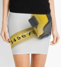 a yellow measuring tape on white background Mini Skirt
