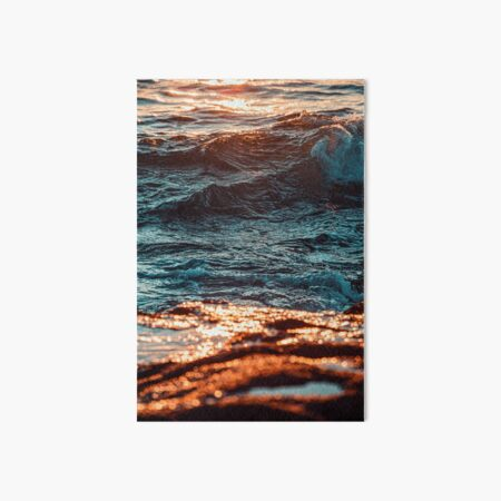 Water Waves on Brown Rocky Shore During Sunset Art Board Print