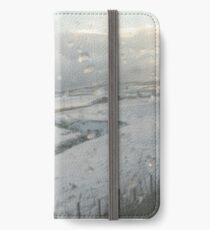 Slicing through the snowy landscape iPhone Wallet/Case/Skin