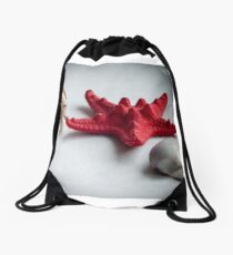 A sea snail shell, red starfish and white clam Drawstring Bag