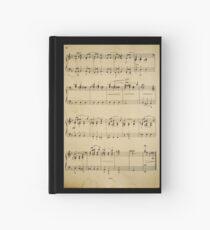 Cuaderno de tapa dura fragmento con notas musicales