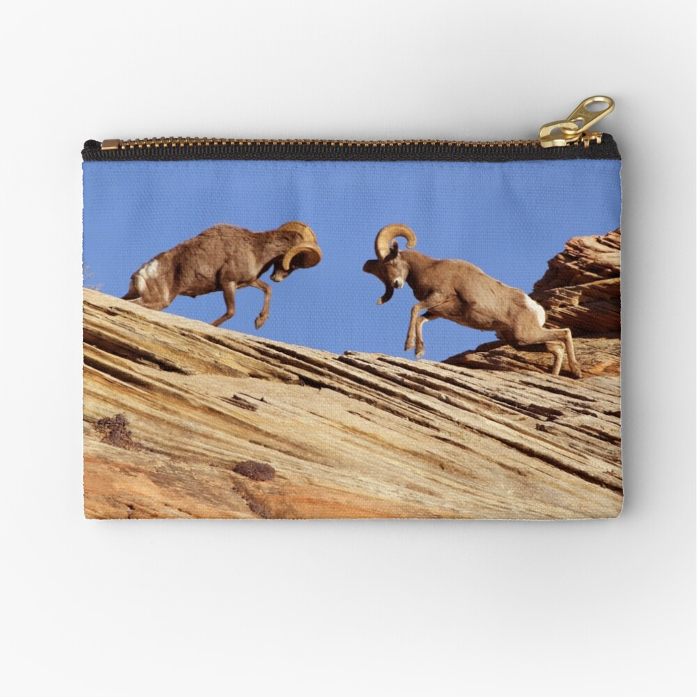 Bighorns Battling in Red Rock Country Zipper Pouch