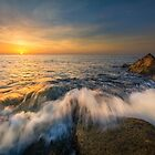 Sunrise and breaking waves at Cala del Morro Blanc by Ralph Goldsmith