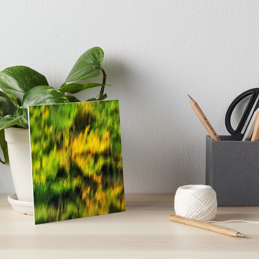Abstract autumn colours reflected in the river Art Board Print
