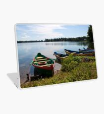 Boats on a lake Laptop Skin