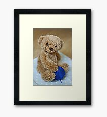 Baby Bear Playing with Some Wool Framed Print