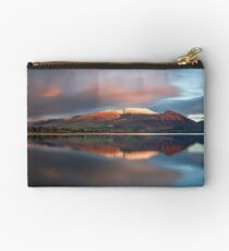 Sunset over the white summit of Skiddaw in the English Lake District Zipper Pouch