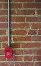 Fire Alarm on Brick Wall by John Ayo