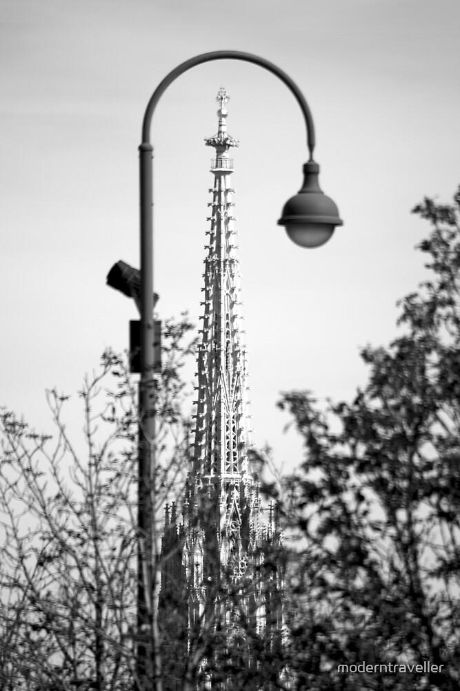 Church spire through a lamppost by moderntraveller