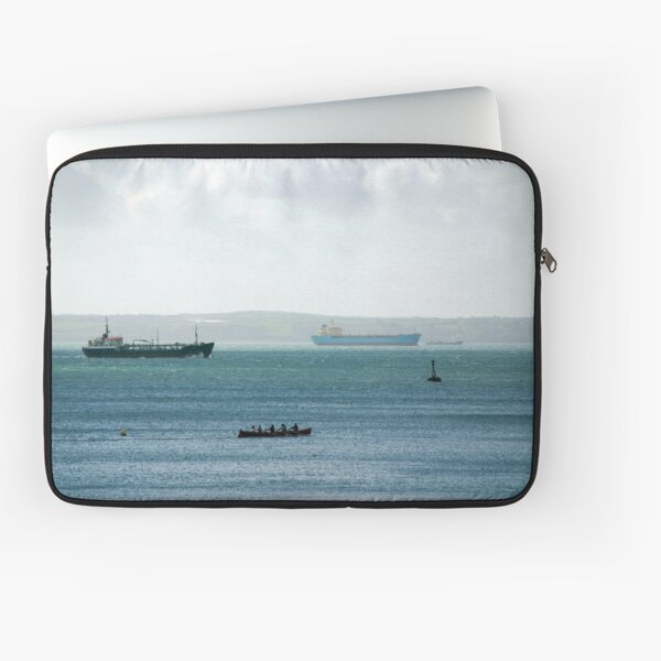 Silhouette of Gig boat racers with large cargo ships in background, St Mawes, Cornwall Laptop Sleeve
